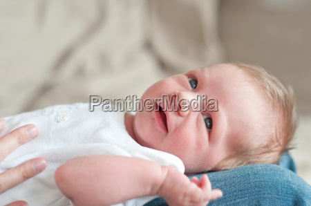 mother holding infant son on lap