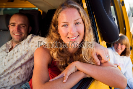 couple in a van smiling with