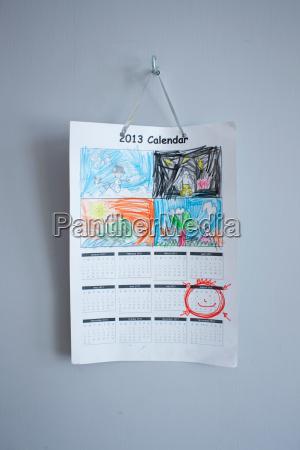 childhood drawings on calendar hanging on