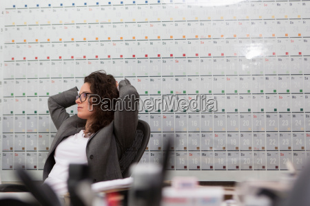 woman sitting in office chair in