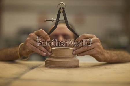 close up of carpenter measuring turning