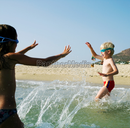 young girl and young boy playing