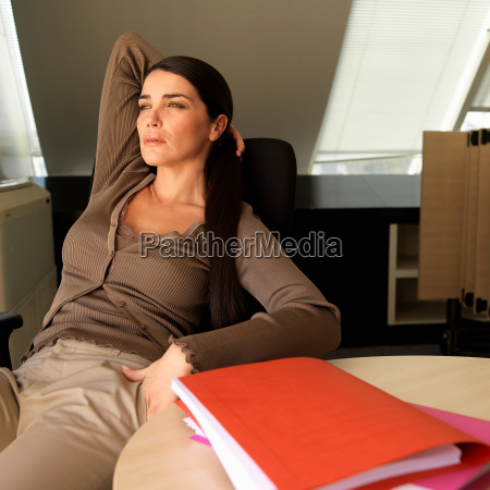woman reclining at desk