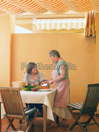 senior woman preparing food at home