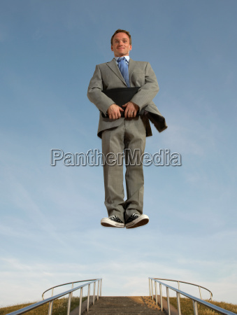 businessman hovering above the ground