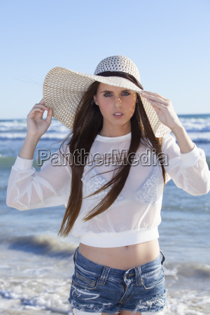 young woman with a hat on