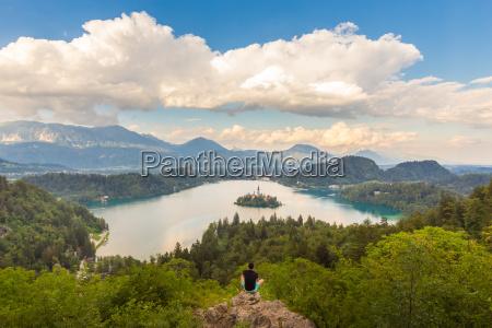 man enjoying panoramic view of lake