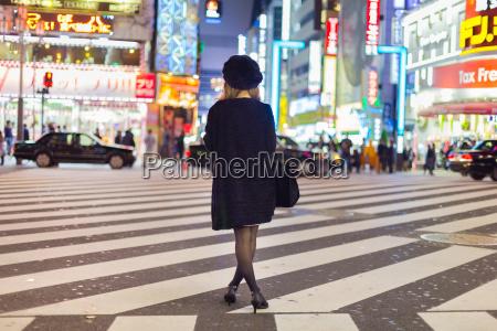 solitary woman in shinjuku tokyo japan
