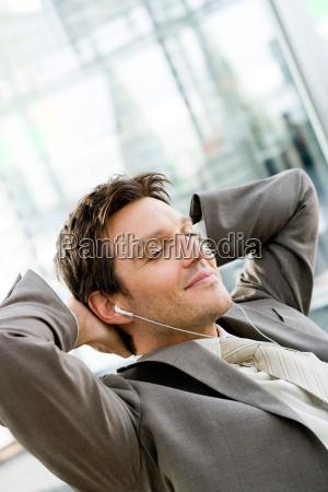 man listening wearing headphones