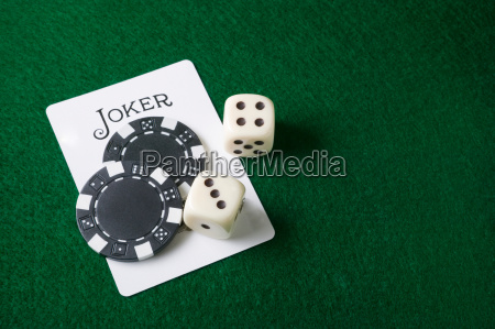 joker card and gambling chips and
