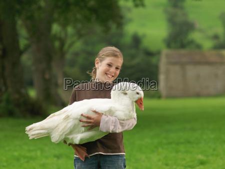 girl holding goose