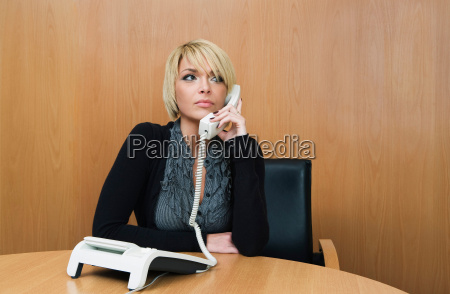 woman on phone in boardroom