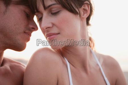 couple kissing sitting on the beach