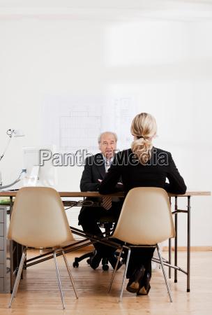 senior businessman talking to a woman