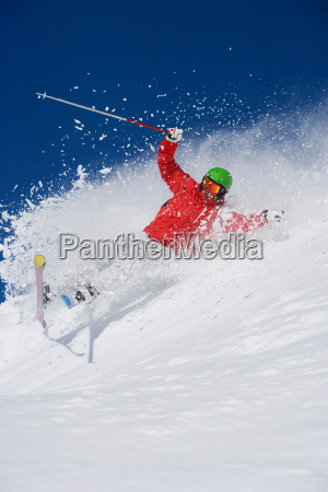 man in red falling mid carve