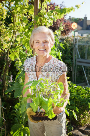 woman holding small green bean