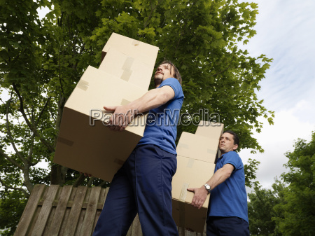 two men carrying boxes