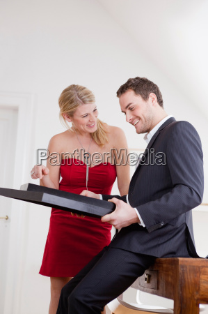 couple looking at framed pictures