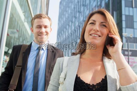 businesspeople walking on city street