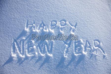 happy new year written in snow