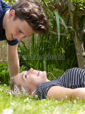 smiling couple playing in grass