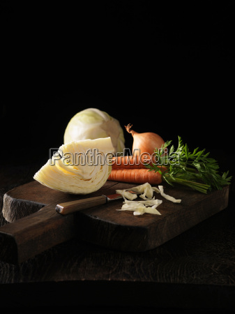 onion carrot and cabbage on board