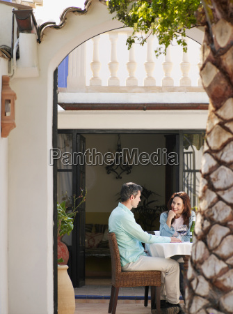 couple sitting on garden terrace