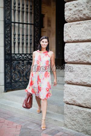 smiling, woman, walking, on, city, street - 18322708