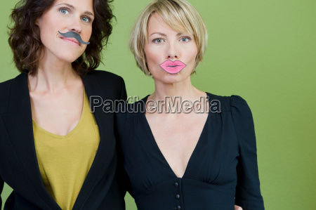 women wearing fake lips and mustache