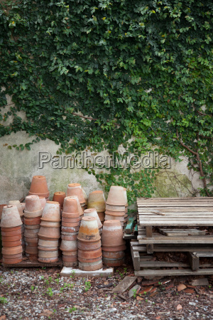 terracotta plant pots by wall with