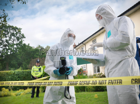 forensic scientists in discussion at crime