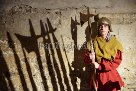 boy in armour with weapon bolton
