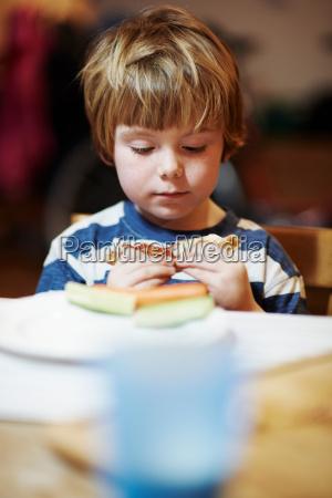 boy eating at table