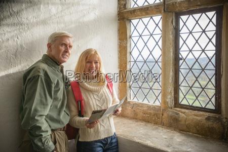 couple by window in bolton castle