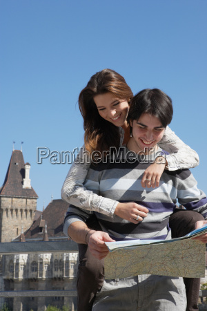 couple looking at a map outdoors