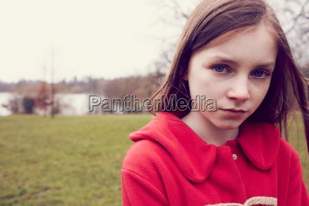 portrait of pensive girl outdoors