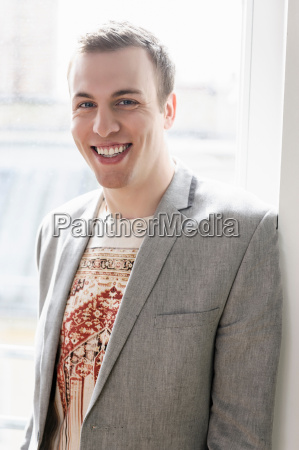 man in jacket with wide smile