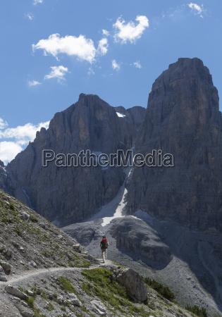 climber approaching rocky peak brenta dolomites