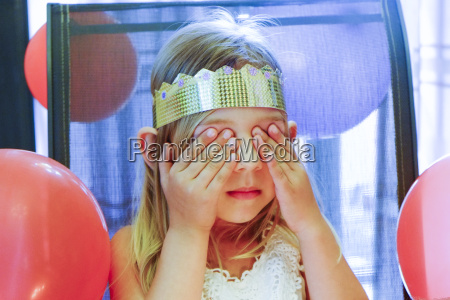 girl with closed eyes making birthday