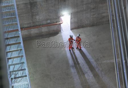 civil engineers in discussion in suspension