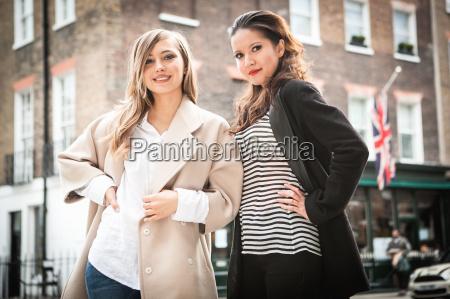 women posing on street london uk