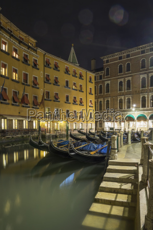 canal steps and gondolas at night