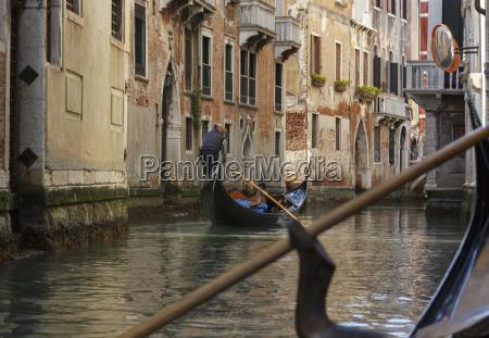 gondolas on canal waterway venice veneto