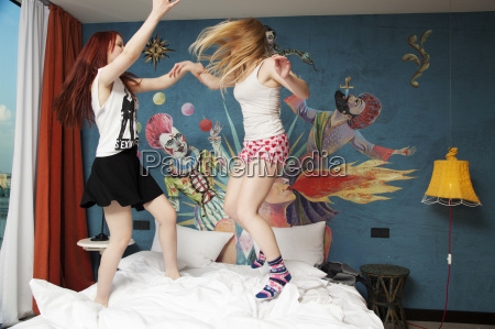two young women dancing on hotel