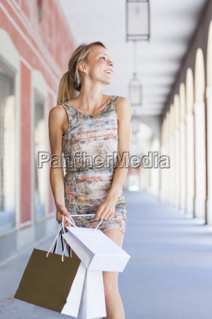 young woman carrying shopping bags in