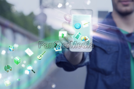 young man holding up smartphone with