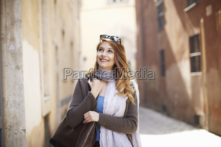 young sophisticated woman exploring streets rome