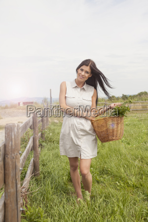 young woman with basket of vegetable