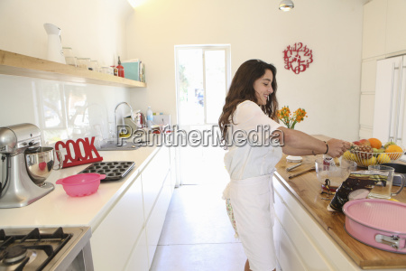 teenage girl in white apron