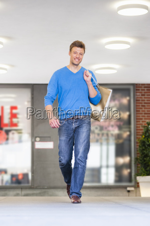 portrait of mid adult man carrying